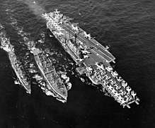 USS Bellatrix (AF-62) replenishes USS Coral Sea (CVA-43) and USS Duncan (DDR-874) on 16 April 1962 (NH 97649).jpg