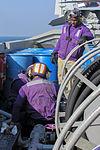USS Carl Vinson Sailors repair a fueling station swing joint 141205-N-TJ675-029.jpg