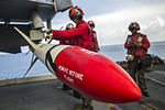 USS George Washington weapons department Sailors mount ordnance to aircraft 141015-N-XK455-095.jpg