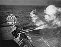 USS Quincy (CA-71) fires on the Kamaishi iron works on 14 July 1945.jpg