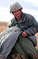 US Army paratrooper recovers parachute 141211-A-QW291-140.jpg