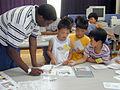 US Navy 020718-N-7669M-001 U.S. Navy Sailor volunteers at local elementary school in Japan.jpg