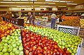 US Navy 020813-N-3642E-503 Navy customers look for ripe apples at the commissary located at Naval Station Norfolk.jpg