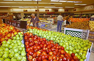Defense Commissary Agency - Exterior and interior views of the commissary at Naval Station Norfolk in August 2002.