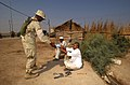 US Navy 031016-N-3236B-022 Sailors and Marines from Expeditionary Strike Group One (ESG-1) distribute water to the people of Al Faw, Iraq.jpg