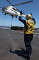 US Navy 040710-N-4757S-056 A flight deck director signals to an SA 330J Puma helicopter, during a vertical replenishment on the flight deck aboard USS Harry S. Truman (CVN 75).jpg