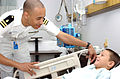 US Navy 040915-N-0000W-121 Lt. Charles Dickerson checks on a young patient in Ward 5B of the U.S. Naval Hospital, Yokosuka.jpg