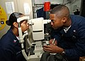 US Navy 040921-N-4374S-005 Hospital Corpsman 2nd Class Renville Marsh, right, makes an adjustment on a Non-Contact Tonometer while performing an eye exam.jpg