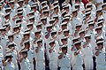 US Navy 050527-N-9693M-008 U.S. Naval Academy Midshipmen salute during the National Anthem as part of the opening ceremonies for the class of 2005 Graduation and Commissioning Ceremony.jpg