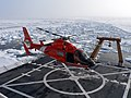 US Navy 050824-N-8108S-001 A U.S. Coast Guard HH-65 Dolphin helicopter prepares to depart the Coast Guard cutter USCGC Healy (WAGB 20) to fly members of a science party to a remote ice floe.jpg