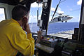 US Navy 060514-N-6501M-002 Aviation Boatswain's Mate Handler 2nd Class Zachary L. Dabney monitors the arrival of an MH-60S Seahawk helicopter assigned to the Sea Combat Squadron Two five (HSC-25).jpg