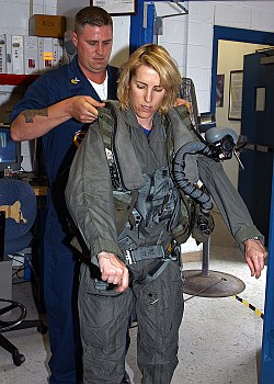 US Navy 070511-N-1082Z-003 Radio talk Show Host and Author, Laura Ingraham, gets fitted for flight gear by Aircrew Survival Equipmentman 1st Class James Dickerson