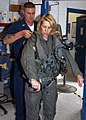 US Navy 070511-N-1082Z-003 Radio talk Show Host and Author, Laura Ingraham, gets fitted for flight gear by Aircrew Survival Equipmentman 1st Class James Dickerson.jpg