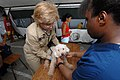 US Navy 070630-N-8704K-042 Lt. Cmdr. Catherine Rockwell, attached to the Military Sealift Command hospital ship USNS Comfort (T-AH 20), provide veterinary care to a pet at Medical Center Morales.jpg