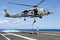 US Navy 070720-N-5928K-007 Explosive ordnance disposal technicians assigned to Explosive Ordnance Disposal Mobile Unit (EODMU) 2, Det. 26, conduct a fast rope exercise from an HH-60H Seahawk.jpg
