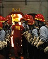 US Navy 070814-N-8848T-051 Machinist's Mate 1st Class Richard Lewis, of Batesville, Ark., leads recruits from Division 253 in fighting a fire at Recruit Training Command's fire fighting school.jpg