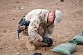 US Navy 070913-N-1003P-028 Lt. Erik Vik, officer-in-charge of Explosive Ordnance Disposal Mobile Unit 8, Det. 20, based in Sigonella, Italy, prepares the Arta range for the disposition of expired ammunition.jpg