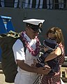 US Navy 070928-N-0995C-044 Chief Cryptologic Technician Davy Feller greets his wife and child after returning to Naval Station Pearl Harbor from deployment aboard guided-missile cruiser USS Chosin (CG 65).jpg