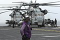 US Navy 071118-N-1778P-128 Aviation Boatswain's Mate (Fuel) 2nd Class Marwin D. Aquino supervises fueling stations ensuring aircraft are fueled aboard the amphibious assault ship USS Essex (LHD 2).jpg