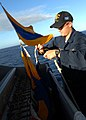 US Navy 080218-N-5476H-132 Quartermaster Seaman Jason Strom, a native of Brandon, Minn., attaches a signal flag to be hoisted up during a signaling drill between the guided-missile cruiser USS Lake Erie (CG 70).jpg
