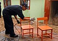 US Navy 080622-N-1226D-086 oberto Olivares, a Peruvian sailor, paints school chairs during a community relations project during UNITAS 49-08.jpg