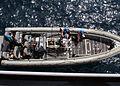 US Navy 081009-N-6764G-093 Sailors lower a rigid hull inflatable boat aboard the amphibious transport dock ship USS San Antonio (LPD 17).jpg