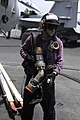 US Navy 090623-N-6604E-065 Aviation Boatswain's Mate (Fuel) Airman Brice Ellis prepares to attach a fuel hose to an aircraft during flight operations aboard the aircraft carrier USS Dwight D. Eisenhower (CVN 69).jpg
