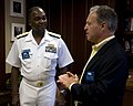US Navy 100812-N-2389S-014 Rear Adm. Kenneth Carodine meets the president and CEO of the Chicago Board Options Exchange as part of Chicago Navy Week.jpg