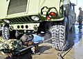US Navy 100929-N-4440L-006 Utilitiesman Constructionman Apprentice Victor Carr cleans a Humvee with a pressure washer at Naval Construction Battali.jpg