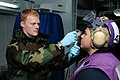 US Navy 110318-N-SG869-019 Engineman 1st Class Brandon Martin, left, uses an IM-271-PD Radiacmeter to detect possible surface contaminates on Aviat.jpg