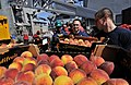 US Navy 110519-N-AG285-277 Sailors aboard the amphibious dock landing ship USS Whidbey Island (LSD 41) move crates of peaches during a vertical rep.jpg