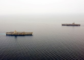 Carrier Strike Group 12 - Enterprise (left) and George H.W. Bush at the Strait of Bab el Mandeb (21 June 2011)