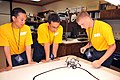 US Navy 110720-N-FO977-026 Navy Junior ROTC cadets, from left, Keane Correa, John Collins and Kevin Gadowski test their robot.jpg