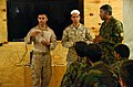 US Navy 110725-M-GW940-007 Lt. Asef Balball, center, a Navy chaplain, speaks through an interpreter with Afghan National Army soldiers during a Mul.jpg