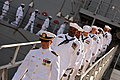 US Navy 110729-N-YR391-012 Sailors assigned to USS Doyle (FFG 39) disembark the ship for the last time during the ship's decommissioning ceremony a.jpg