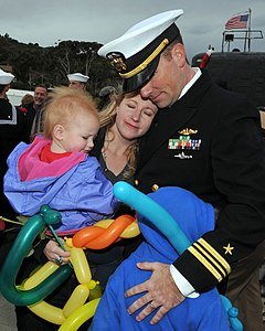 US Navy 111216-N-UD469-191 Lt. Cdr. Ken Douglas, executive officer of the Los Angeles-class attack submarine USS Asheville (SSN 758), hugs his fami.jpg