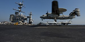 US Navy 111218-N-OY799-655 An E-2C Hawkeye lands aboard the aircraft carrier USS John C. Stennis (CVN 74), marking the Navy's last air mission in s.jpg