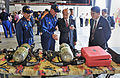 US Navy 121003-N-7441H-004 Guests look over firefighting equipment during a ceremony officially opening the new White Beach Fire Station.jpg