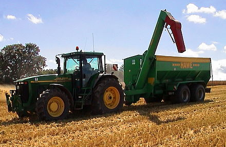 Agriculture production, pictured is a tractor and a chaser bin Ueberladewagen (jha).jpg