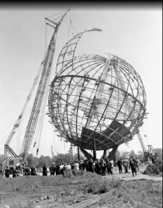 Unisphere - A crane eases the last segment of the Unisphere into place to complete the structure