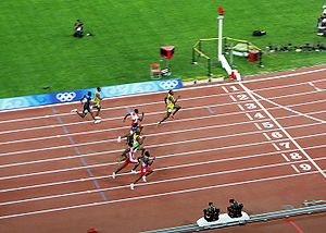 Walter Dix - The 2008 Olympic 100 m final, with Usain Bolt leading and Dix in blue (center).