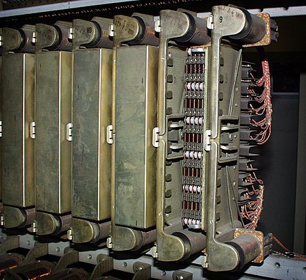 "Several 30-contact relays in ""Connector"" circuits in mid-20th century 1XB switch and 5XB switch telephone exchanges; cover removed on one. Uy-multi1-hy.jpg"