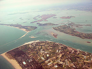 Venetian Lagoon - Aerial view of the Venetian Lagoon, showing many of the islands including Venice itself, center rear, with the bridge to the mainland
