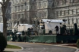 White House press corps - Semi-permanent setup of press corps on the west end of the north White House lawn, from where live media broadcasts with the White House are typically delivered