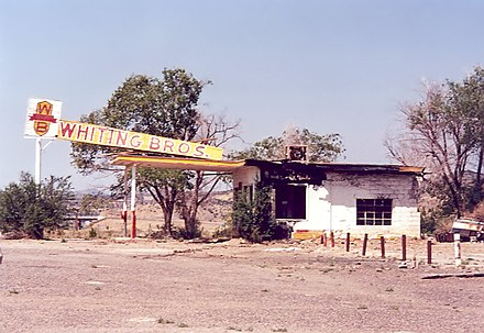 Abandoned, fire-damaged Whiting Brothers gas station. All along the route, preservation efforts are under way to preserve original buildings such as this. Whiting bros.jpg