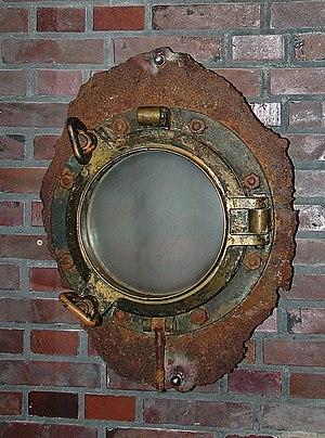 MV Wilhelm Gustloff - A porthole window from Wilhelm Gustloff, salvaged in 1988 by Philip Sayers on behalf of Rudi Lange (the radio operator on board at the time of sinking), was donated to the museum ship Albatross in Damp in 2000. The porthole has two steel bars on the outside.