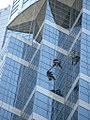 Window washers dangling from City Centre Building in Seattle (4937303534).jpg