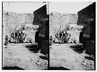 Woman and children in courtyard of house LOC matpc.06314.jpg