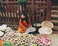 Woman weighs potatoes Nepal.jpg