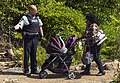 Woman with stroller crossing Canadian border despite this not being an official entry point in order to request asylum, Champlain, NY-Lacolle, QC.jpg